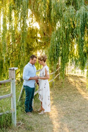 couple under willow tree at sunset