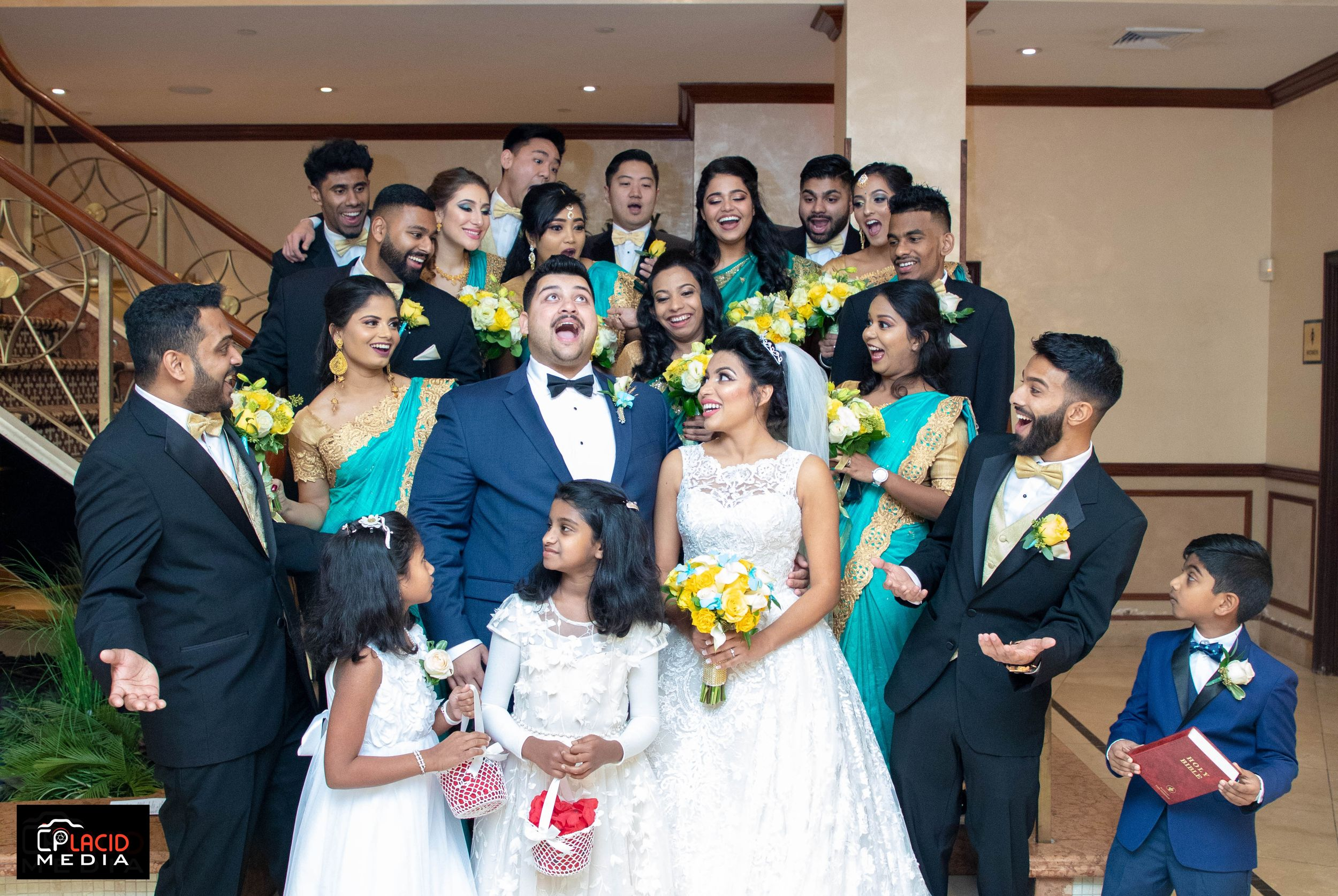 Bridesmaids and Groomsmen laughing on wedding day