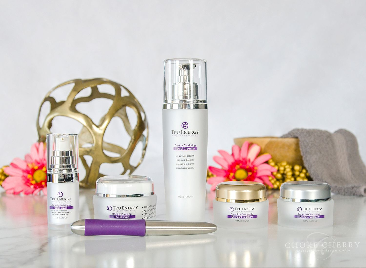 Product photography of high-end luxury skin care line bottles and face wand