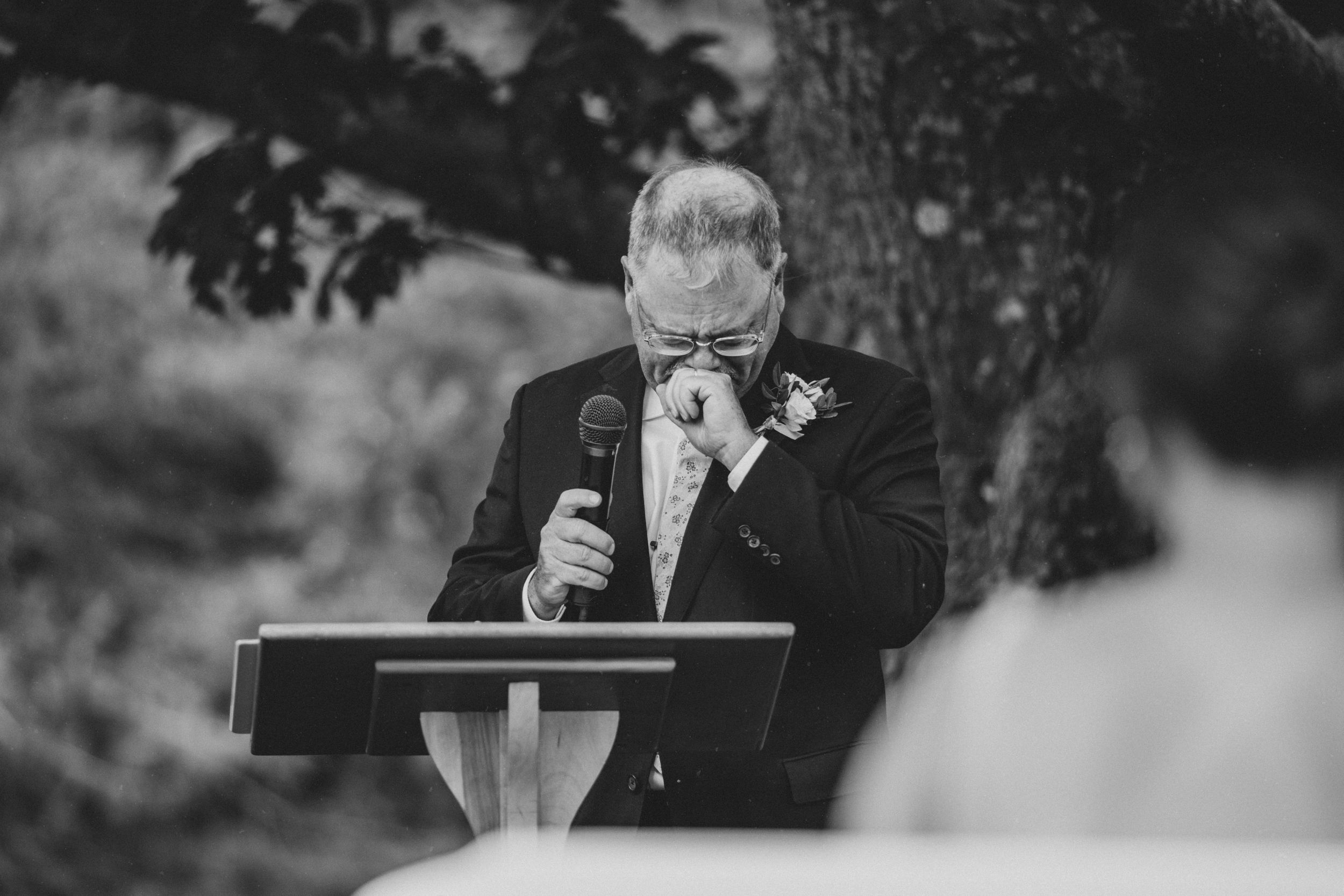 father of the groom getting emotional during an intimate wedding ceremony