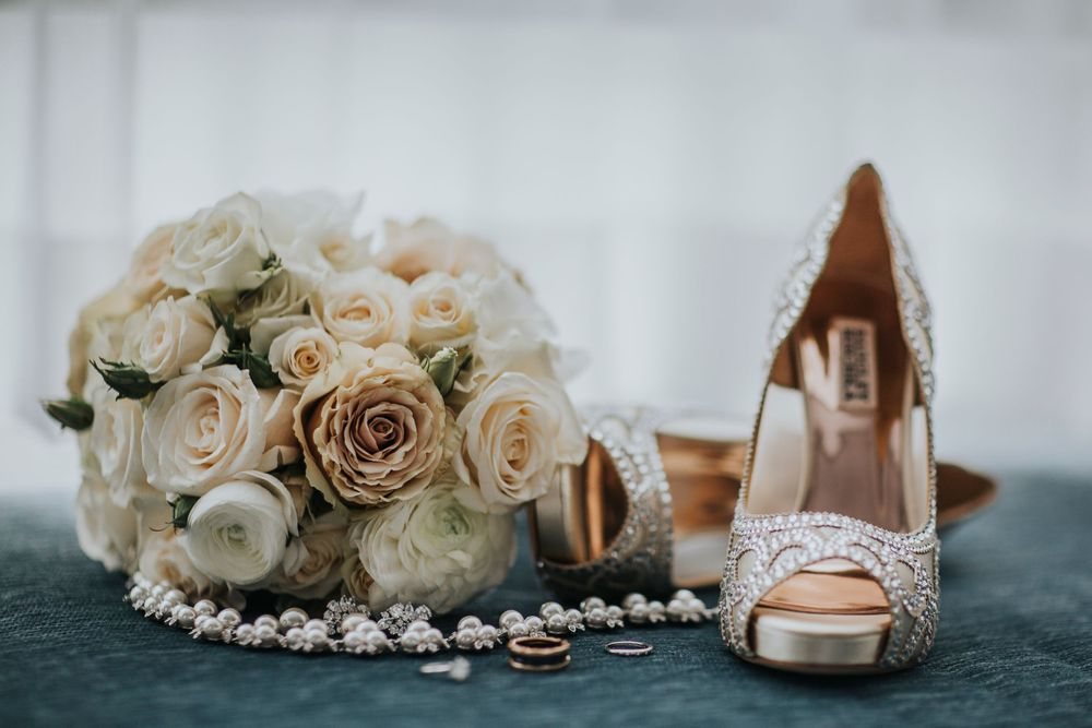 bride's beautiful details set up rings shoes bouquet necklace and earrings
