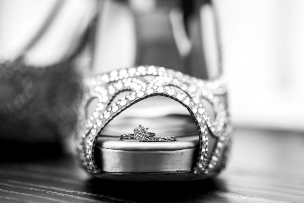 bride's ring sitting at the toe of her shoe