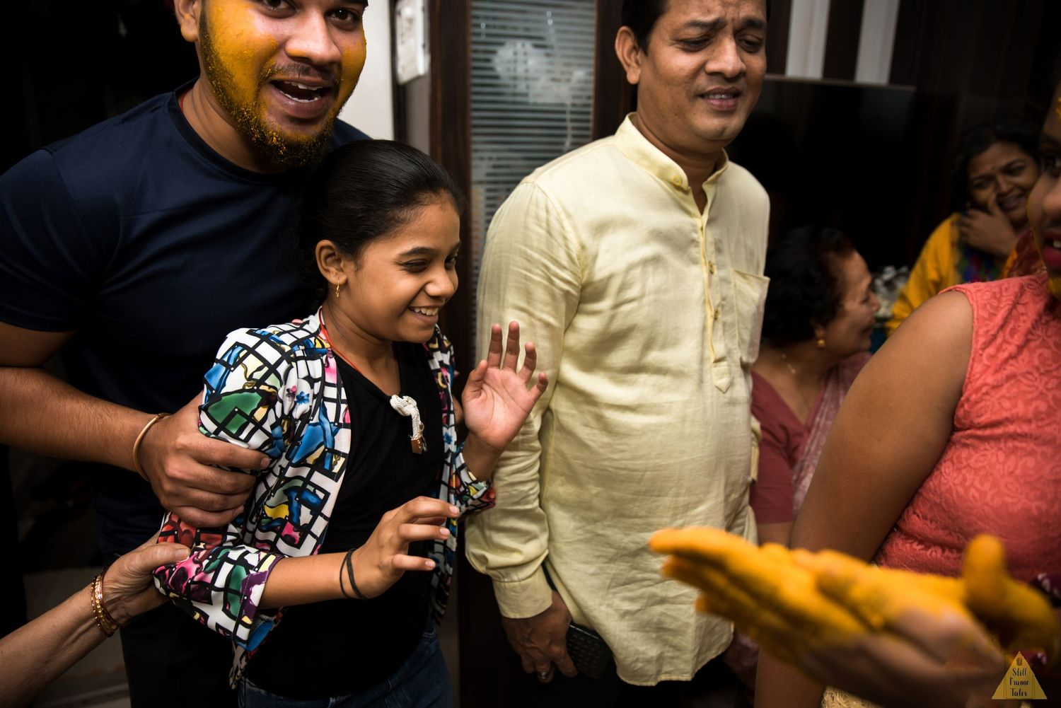 Brother grab sister to put some haldi on her face during haldi ritual