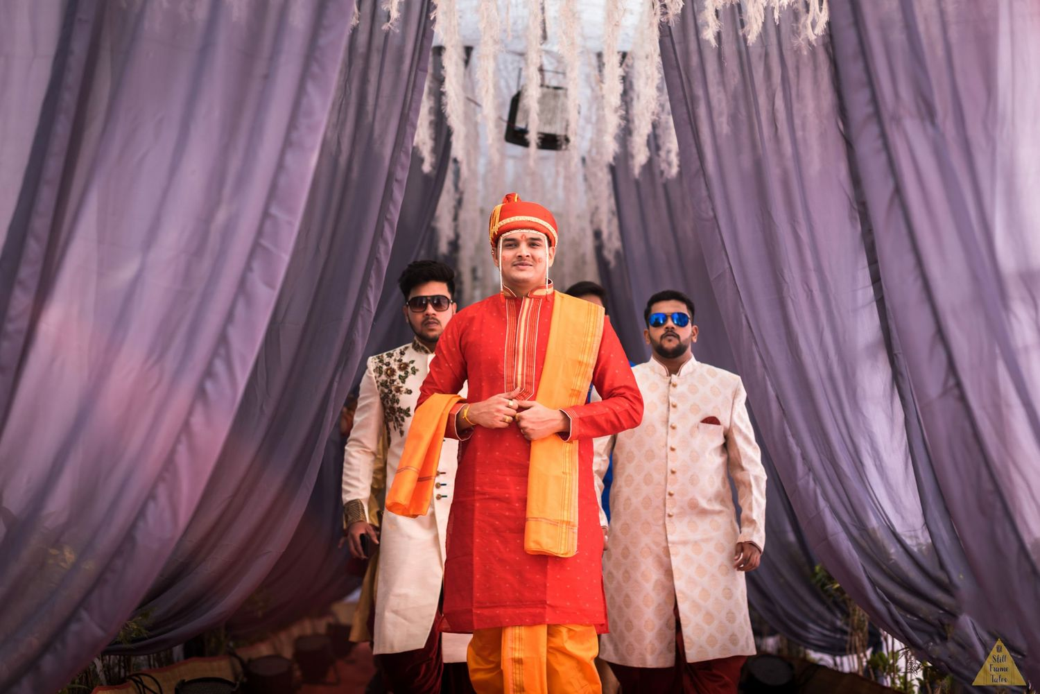 Groom entering at wedding location with his squad