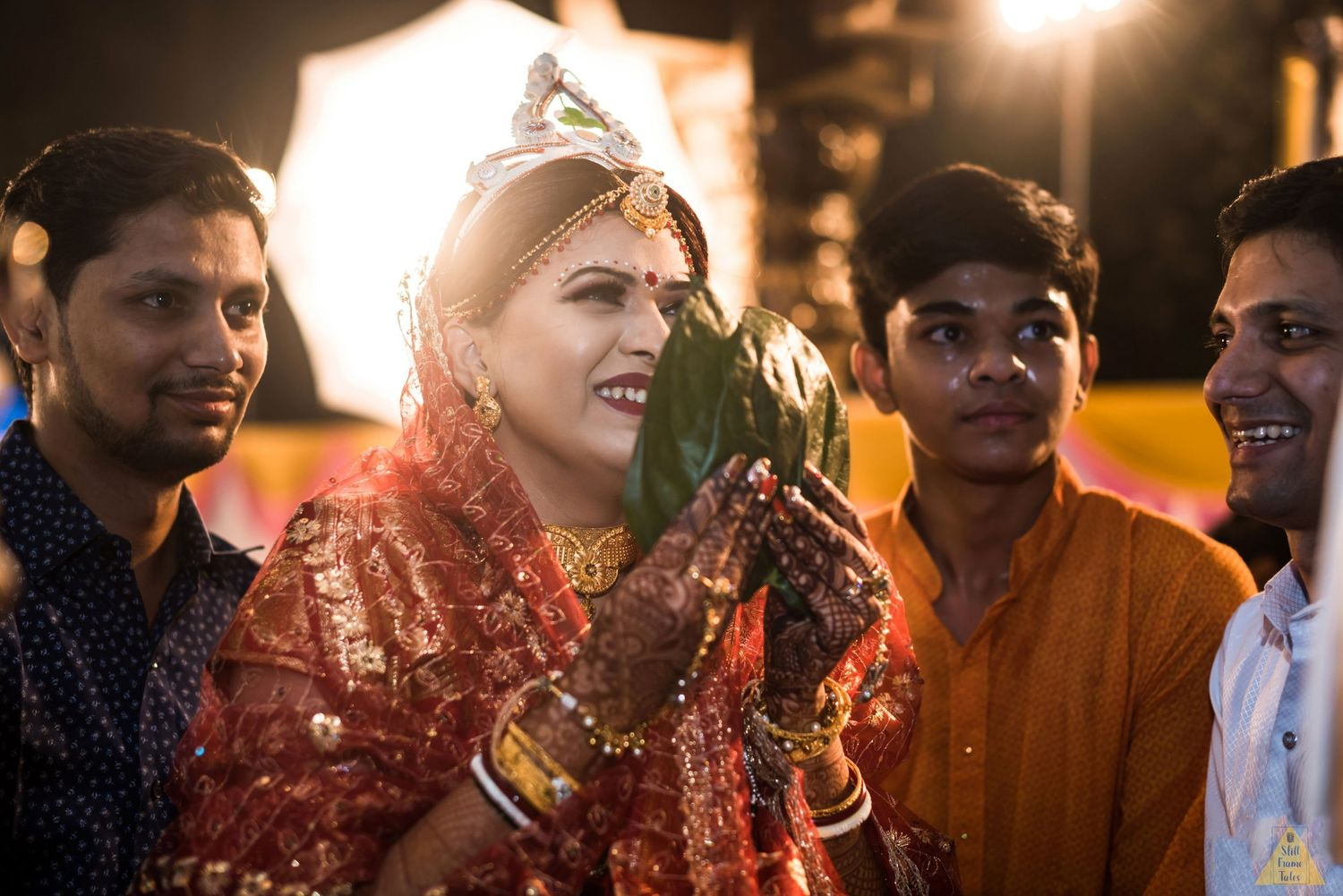 Brothers carry their sister on her wedding day in a bengali wedding ritual