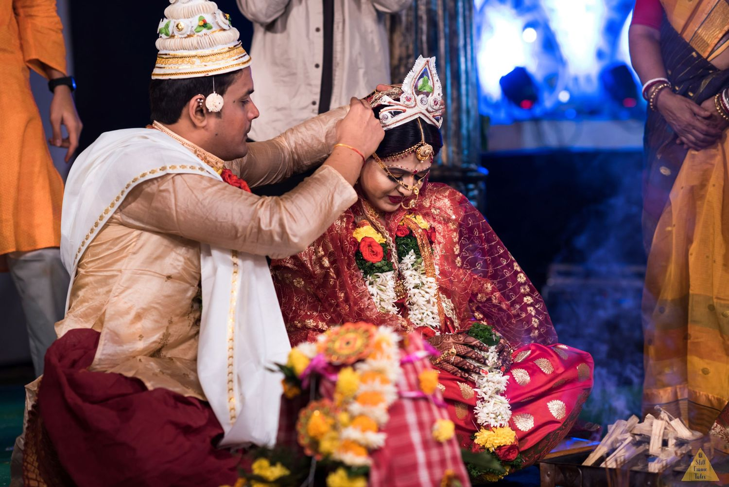 Indian couple performing mngalsutra ritual on their wedding day