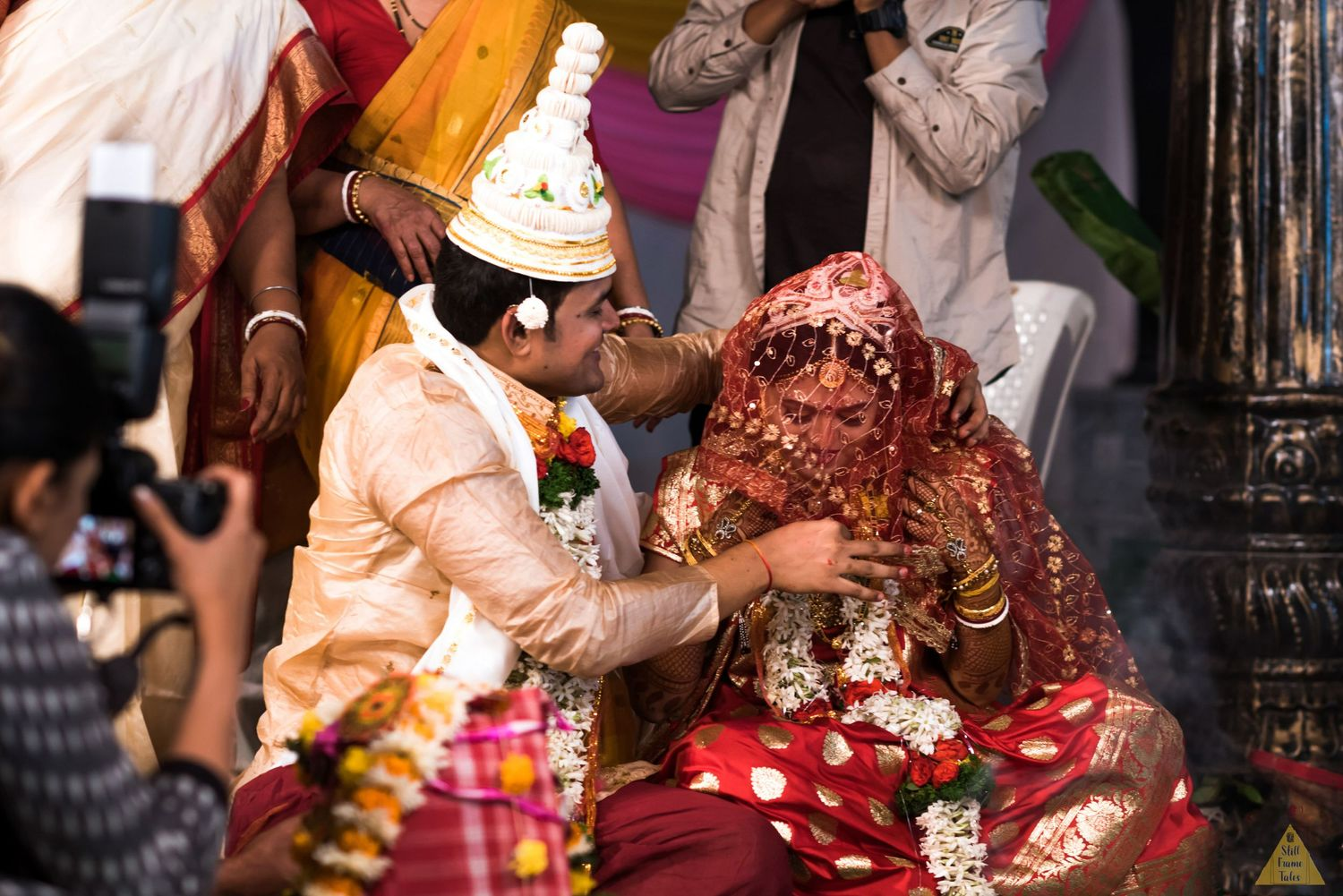 Couple performing Indian wedding ritual