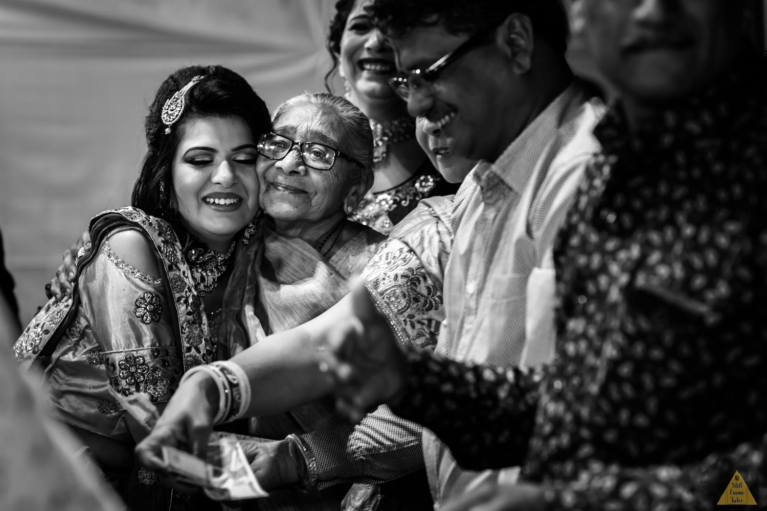 Bride givng warm hug to her grand mother on her wedding day