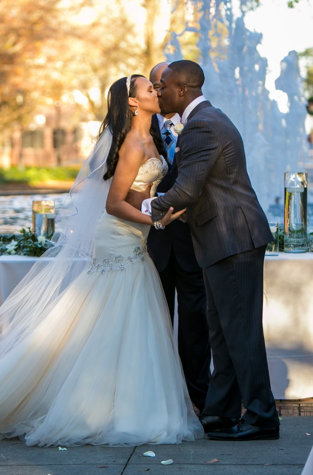 Miranda and Marcus Lattimore's first kiss during their wedding ceremony at the Lace House in Columbia, SC. Ph