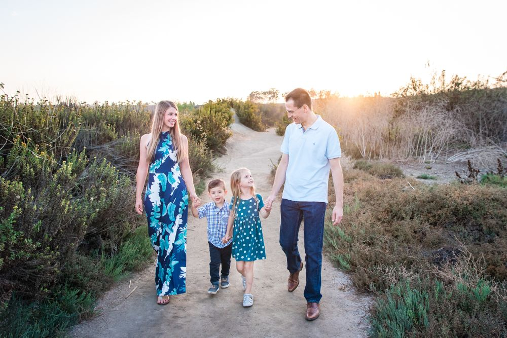 A family walking on a trail along Back Bay in Newport Beach, CA