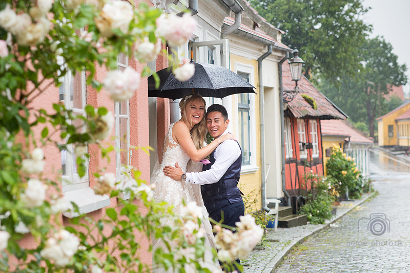 Happy couple in the rain.