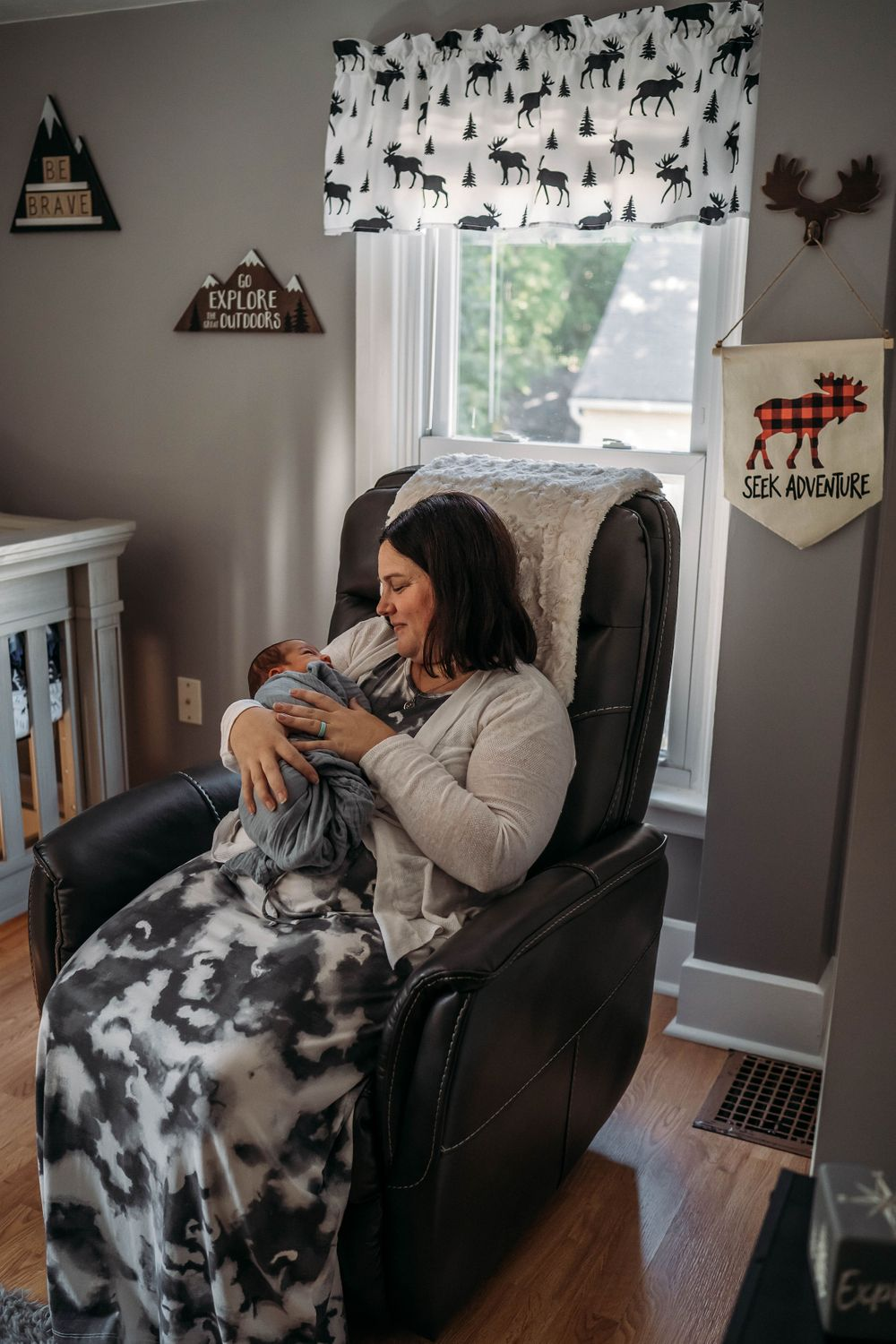 mom holding baby in their boston home