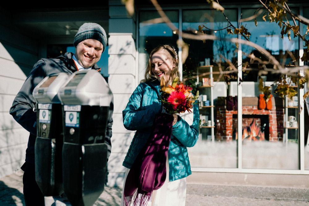 bride-groom-paying-meter-elopement-desmoines-iowa-raelyn-ramey-photography