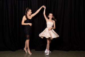 Sisters portrait, dancing together at Bat Mitzvah at 96 Shenley Road - Bat Mitzvah Photography