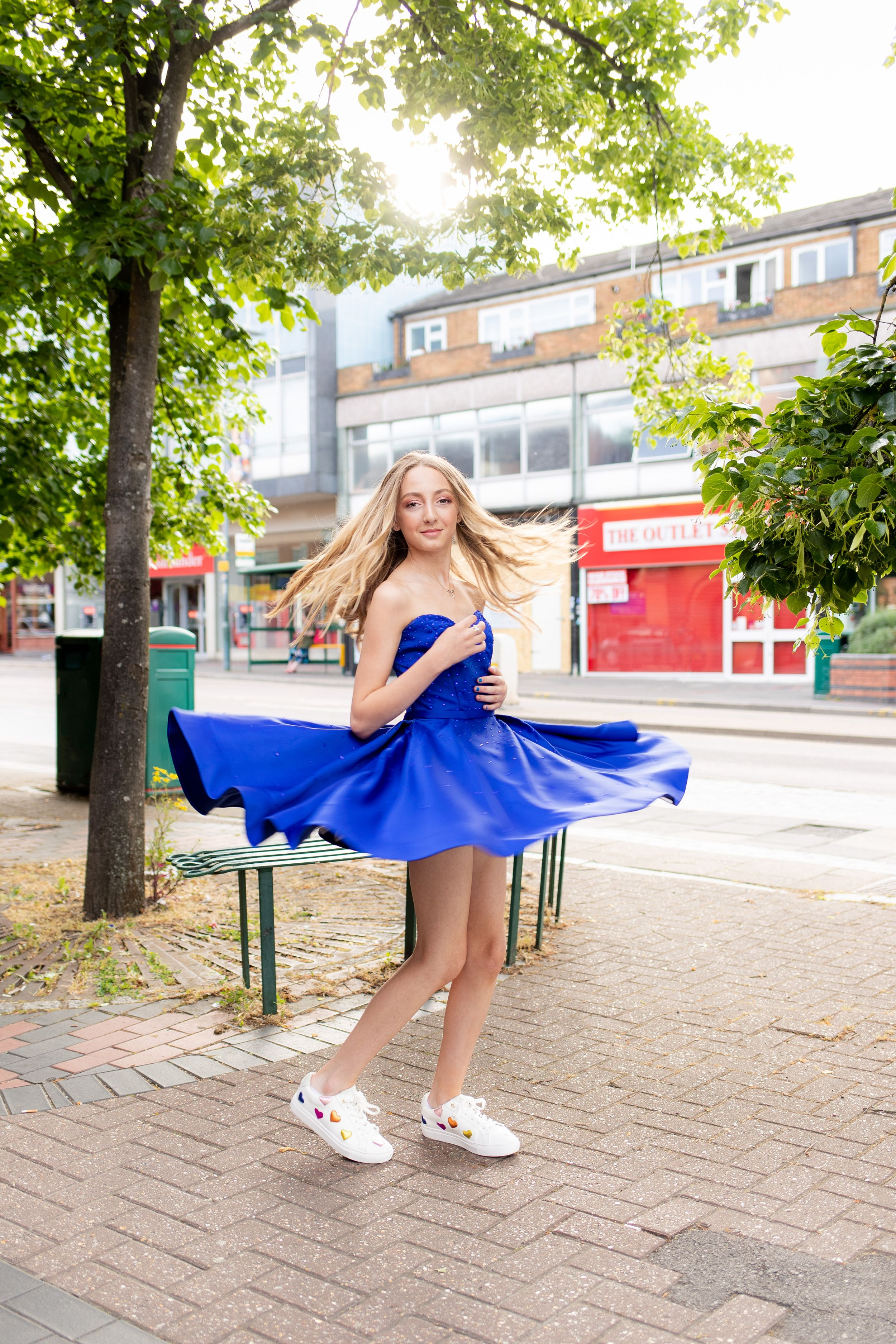 Bat Mitzvah portrait of a girl twirling her dress under a tree - Bat Mitzvah Photography