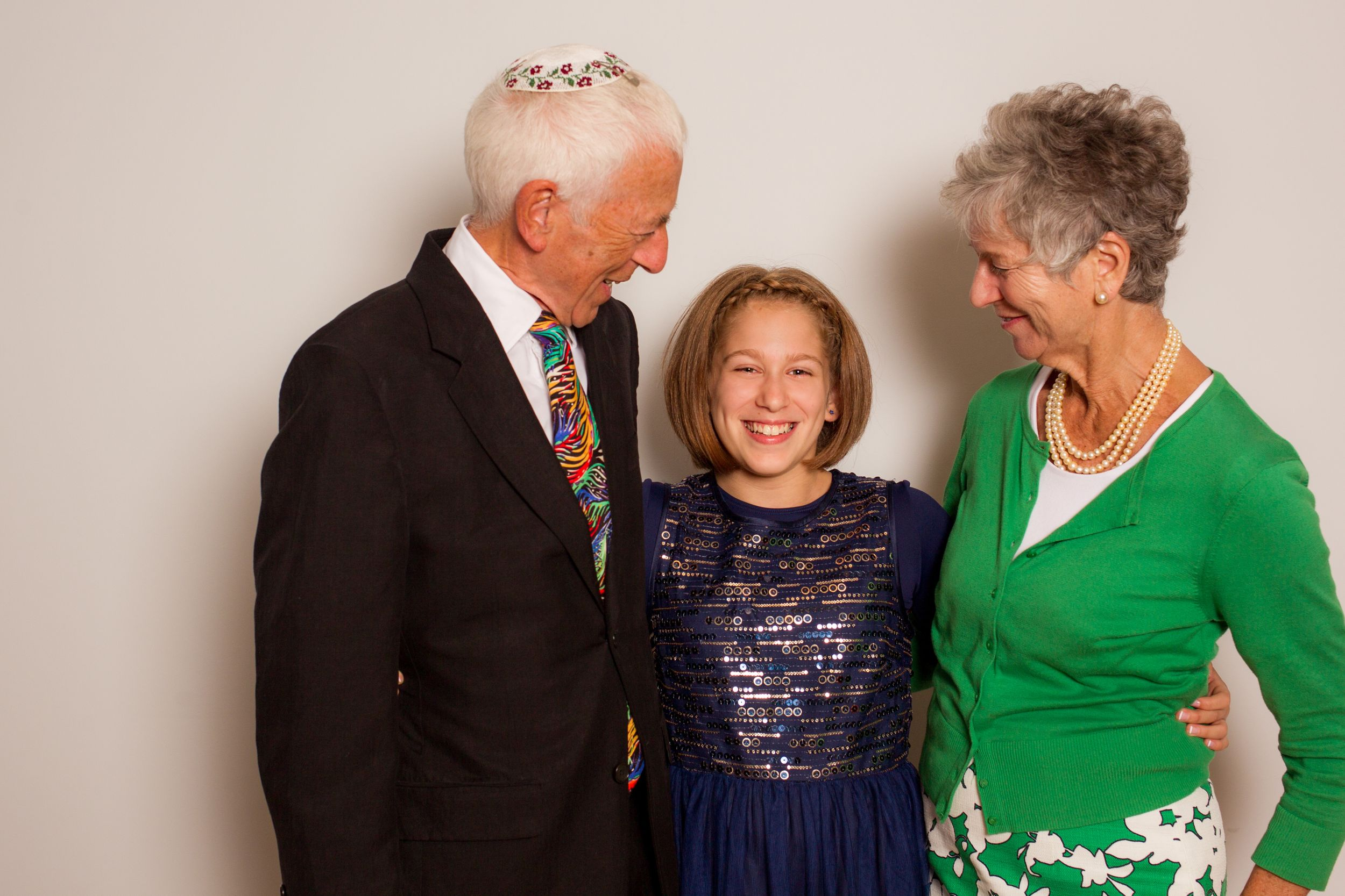 Grandparents pose with their granddaughter at her Bat Mitzvah - Bat Mitzvah Photography