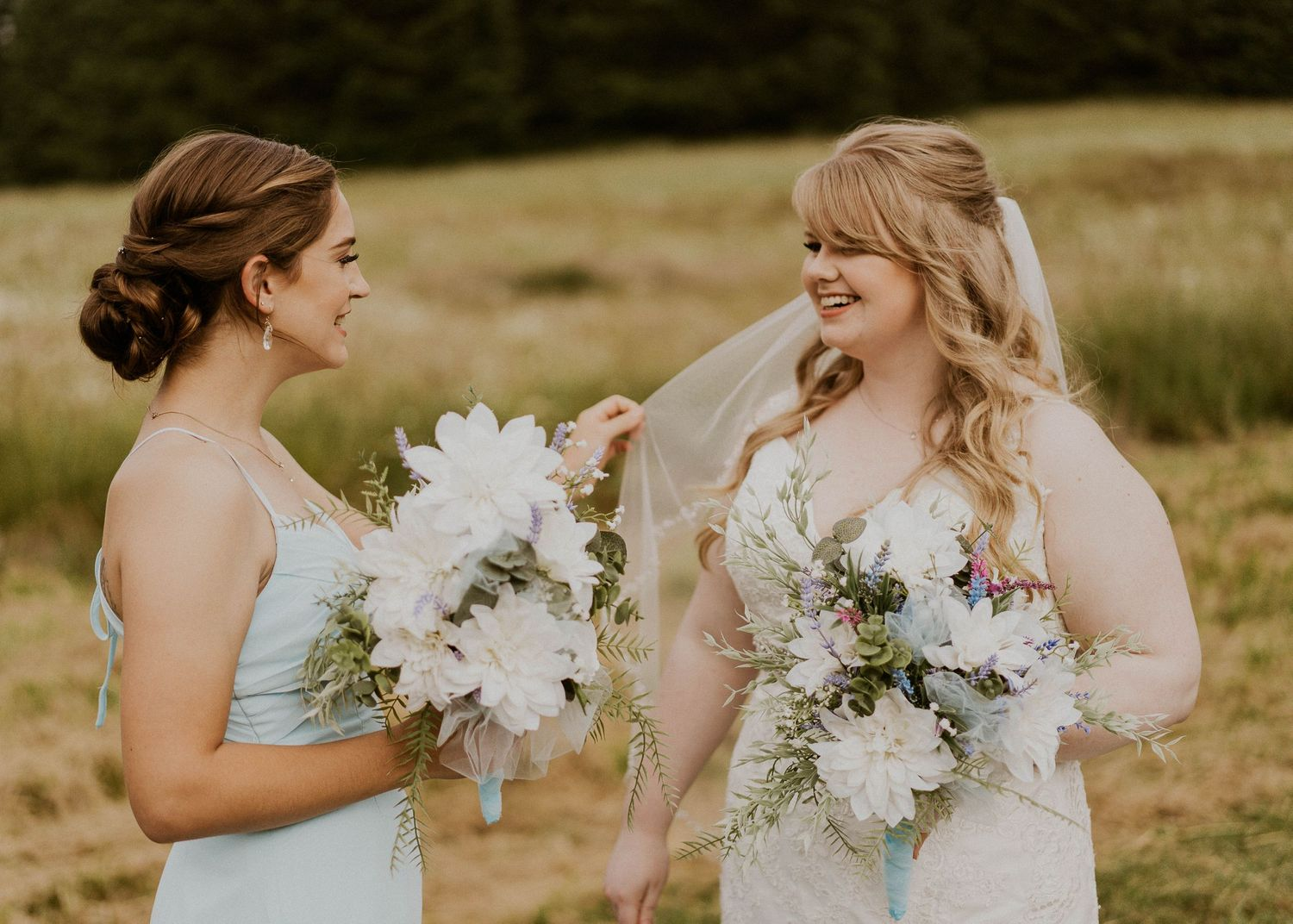 Photo by Kelsie Burke Photography of the bride with a bridesmaid