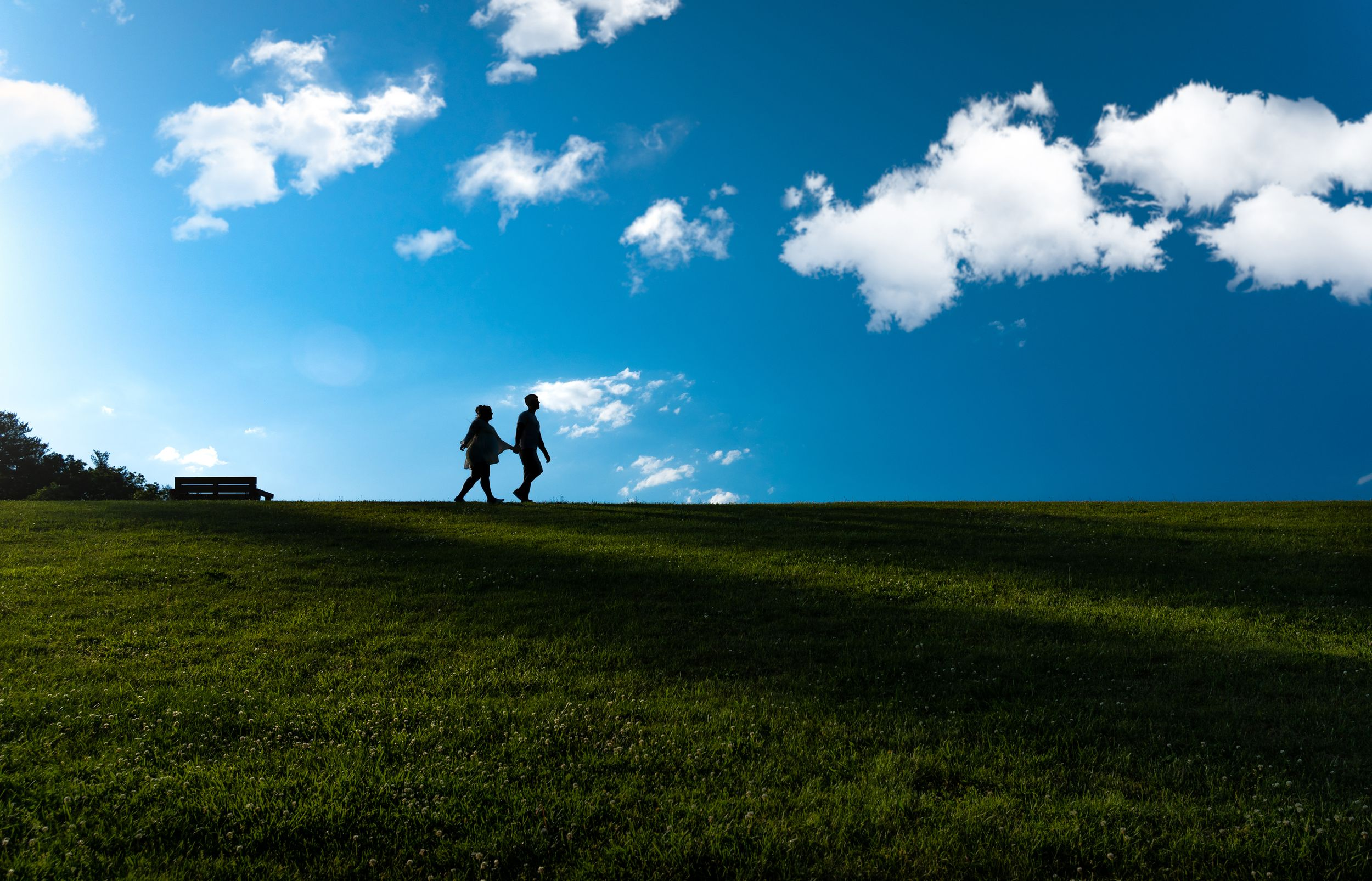 engaged couple walking on a hillside at sweet arrow lake Schuylkill county pa