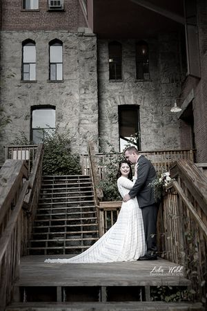 spokane wedding at chetau rive bride and groom hugging photographer luba wold