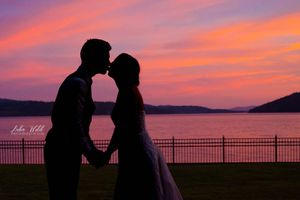 sunset wedding by Coeur d' Alene lake at Jewett House photography by Luba
