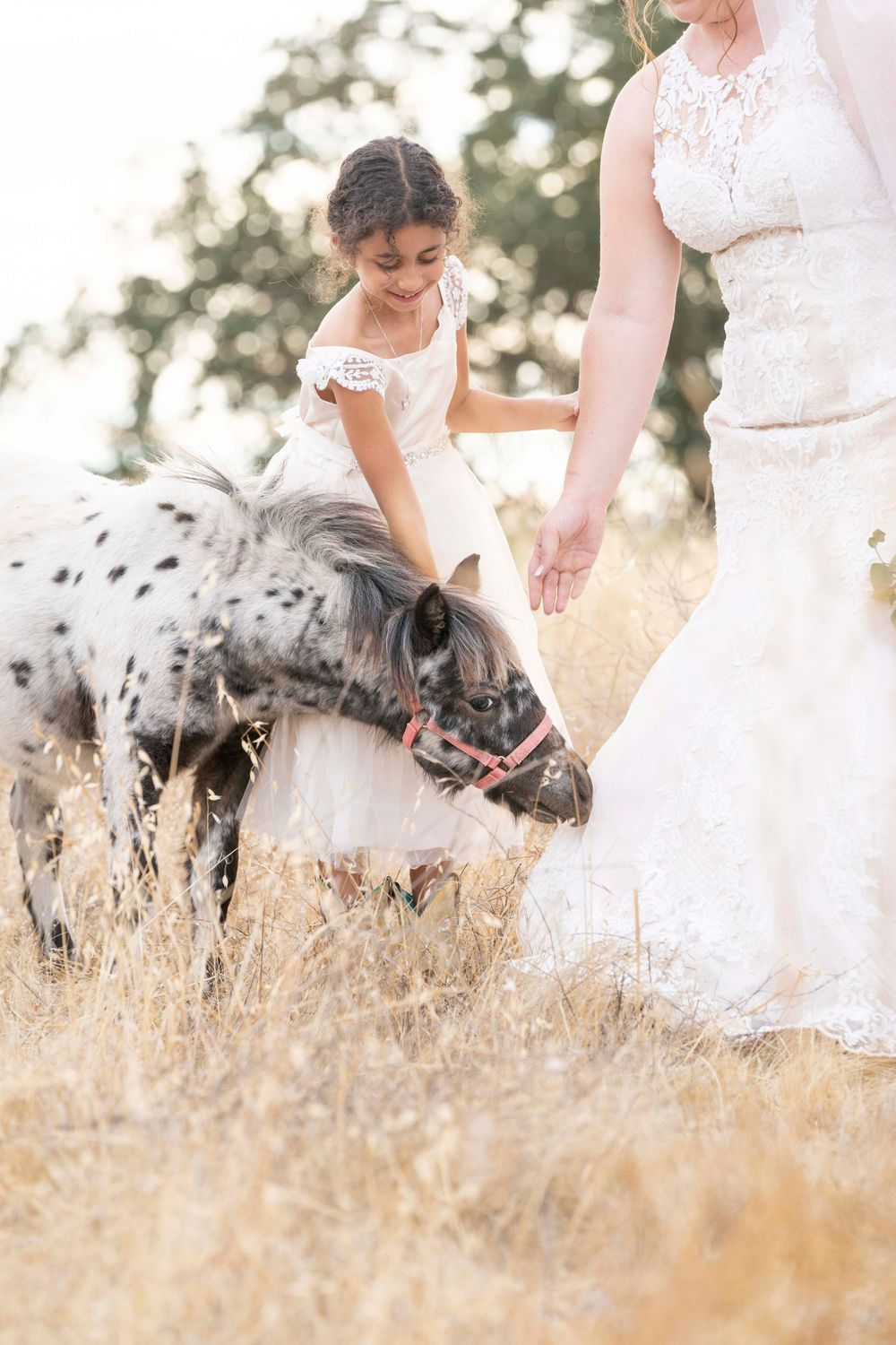 Flower girl with a pony at Fallen Oaks Estate