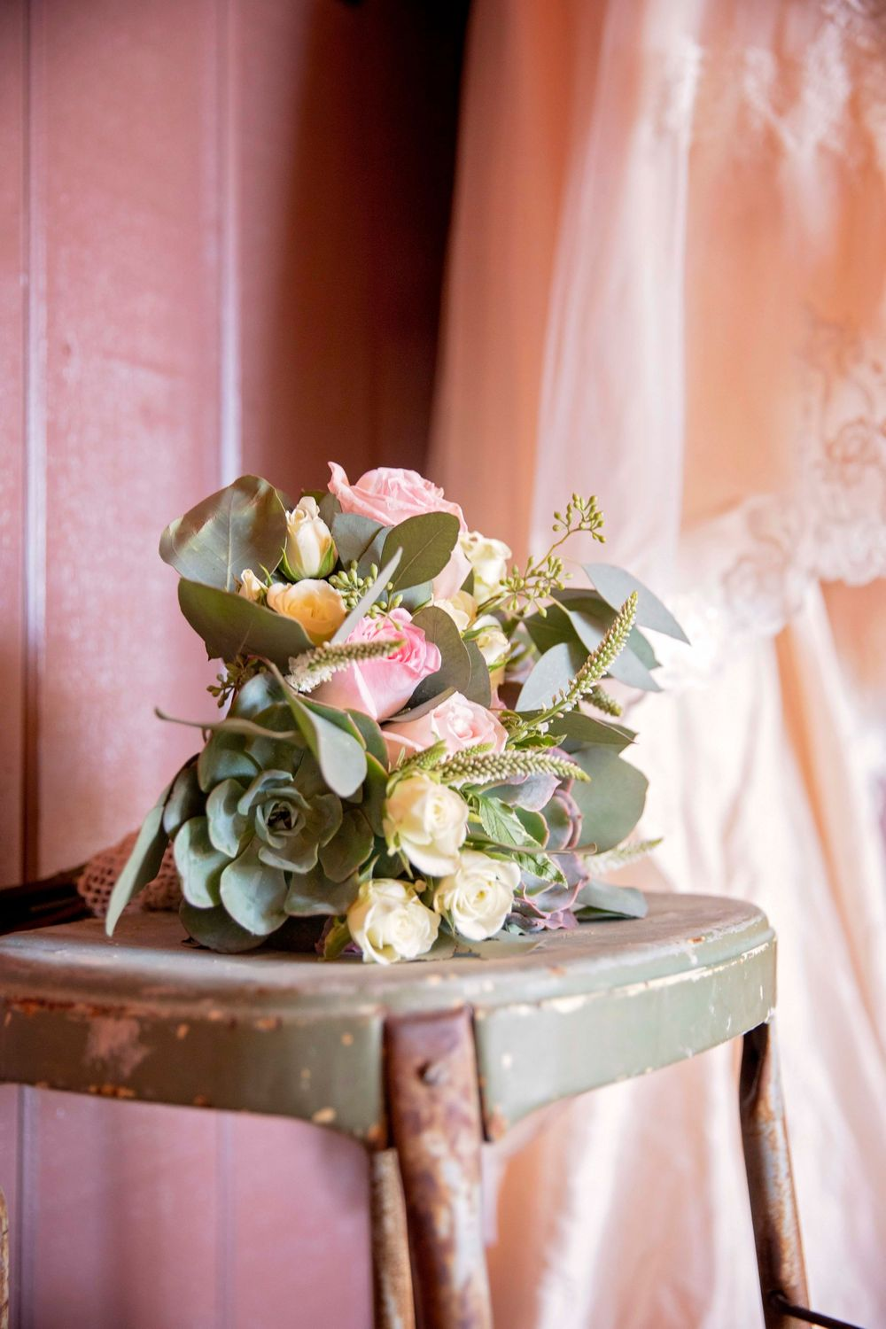 wedding bouquet on a vintage step stool
