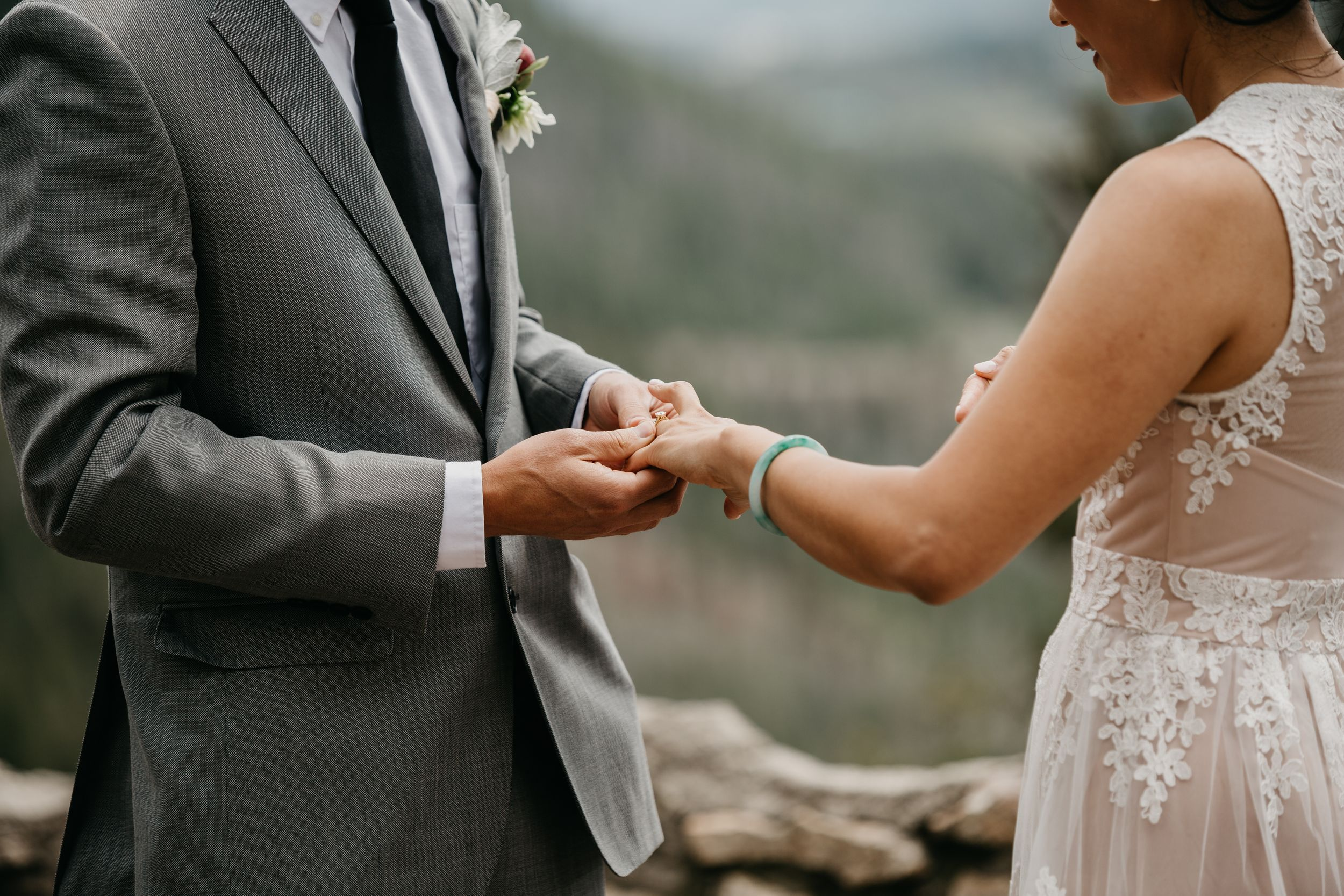 Close up of ring exchange wedding in Colorado