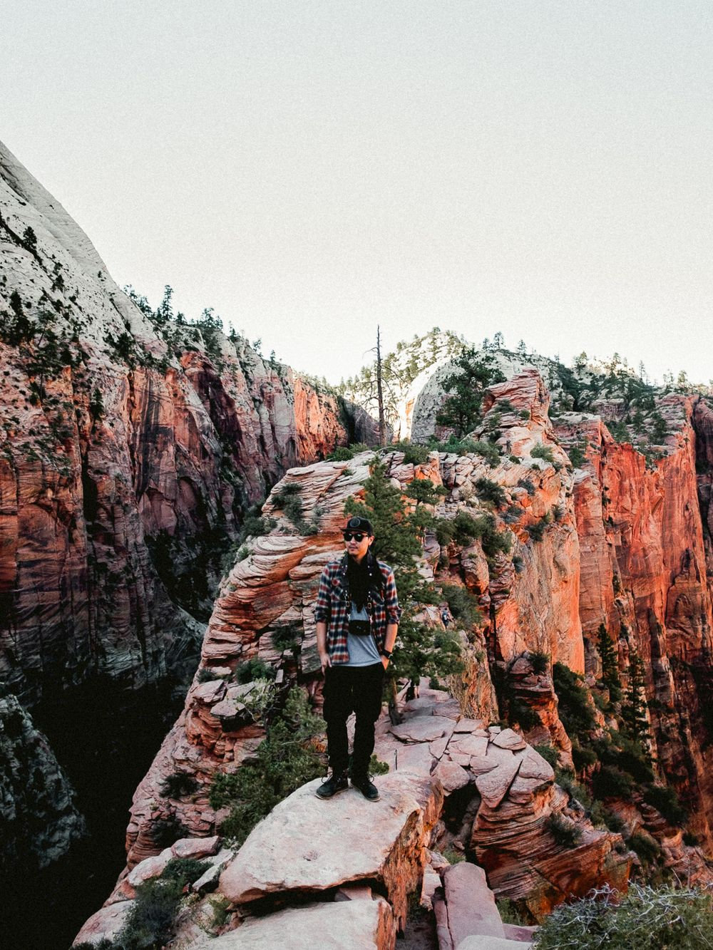 portrait of Mike Yoon standing on rock at Angel's Landing hike in Zion Canyon National Park