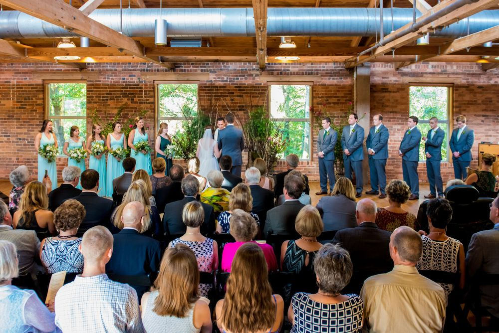 Bride Anna & Groom David exchange vows during their wedding Certus Loft at the Huegonot Mill in Greenville, SC