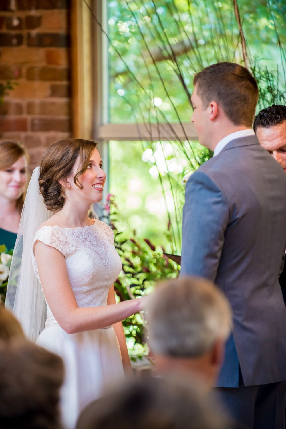 Bride Anna & Groom David exchange vows during their wedding at Certus Loft at the Huegonot Mill in Greenville, SC