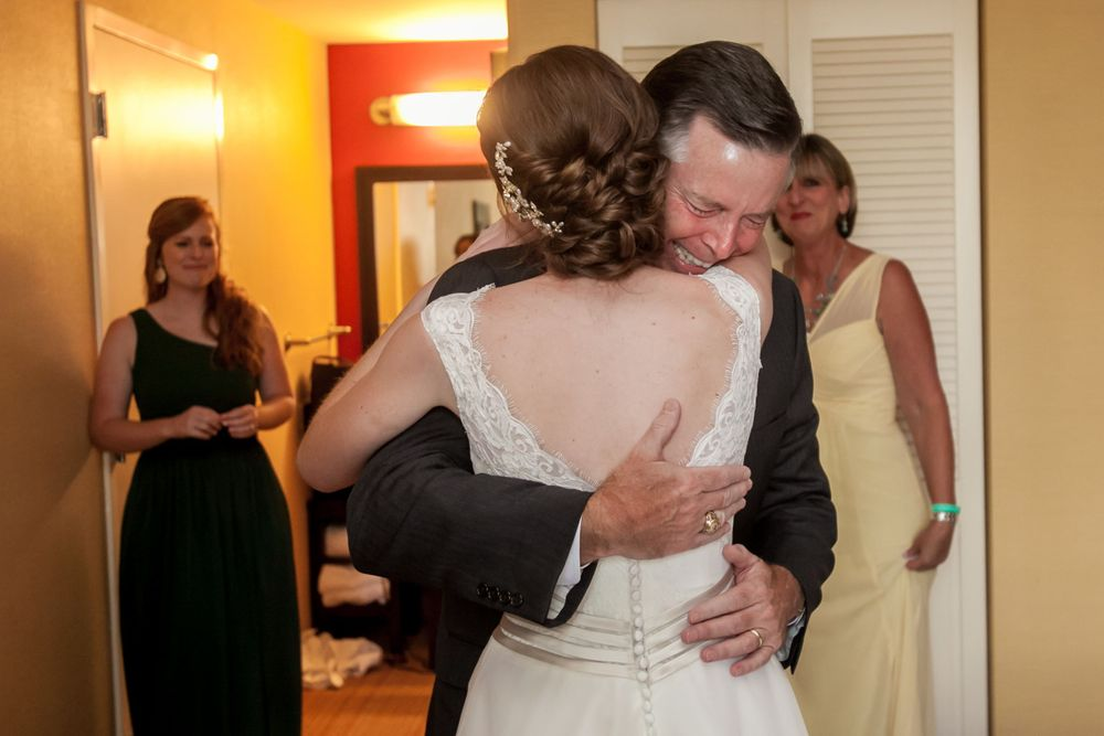 Bride Anna's dad sees her for the first time before her wedding at Certus Loft at the Huegonot Mill in Greenville, SC