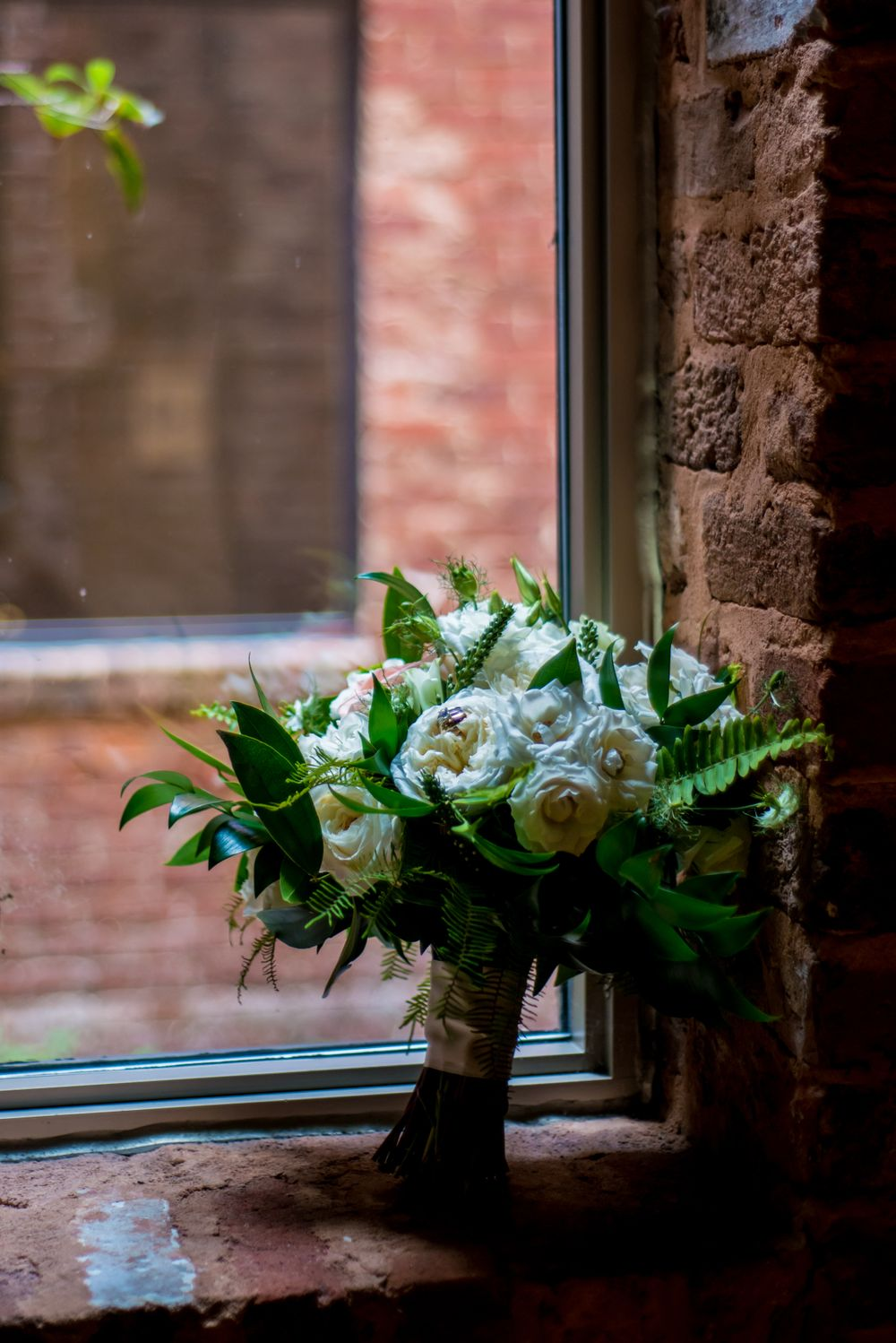 Anna's bridal bouquet before her wedding at Certus Loft at the Huegonot Mill in Greenville, SC