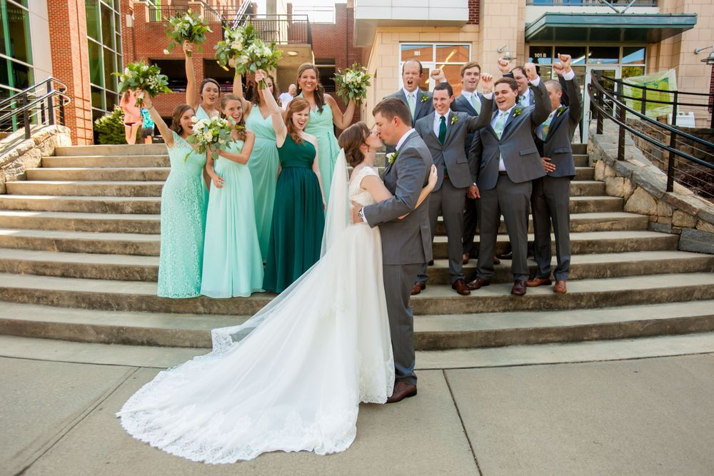 Anna & David with their bridal party after their wedding at Certus Loft at the Huegonot Mill in Greenville, SC