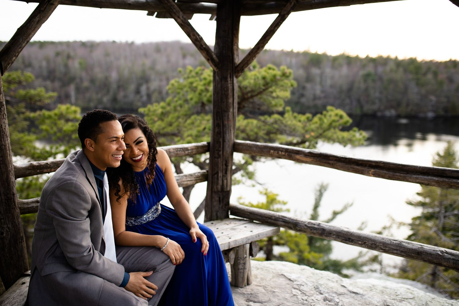 Engaged couple laughing at Minnewaska State Park