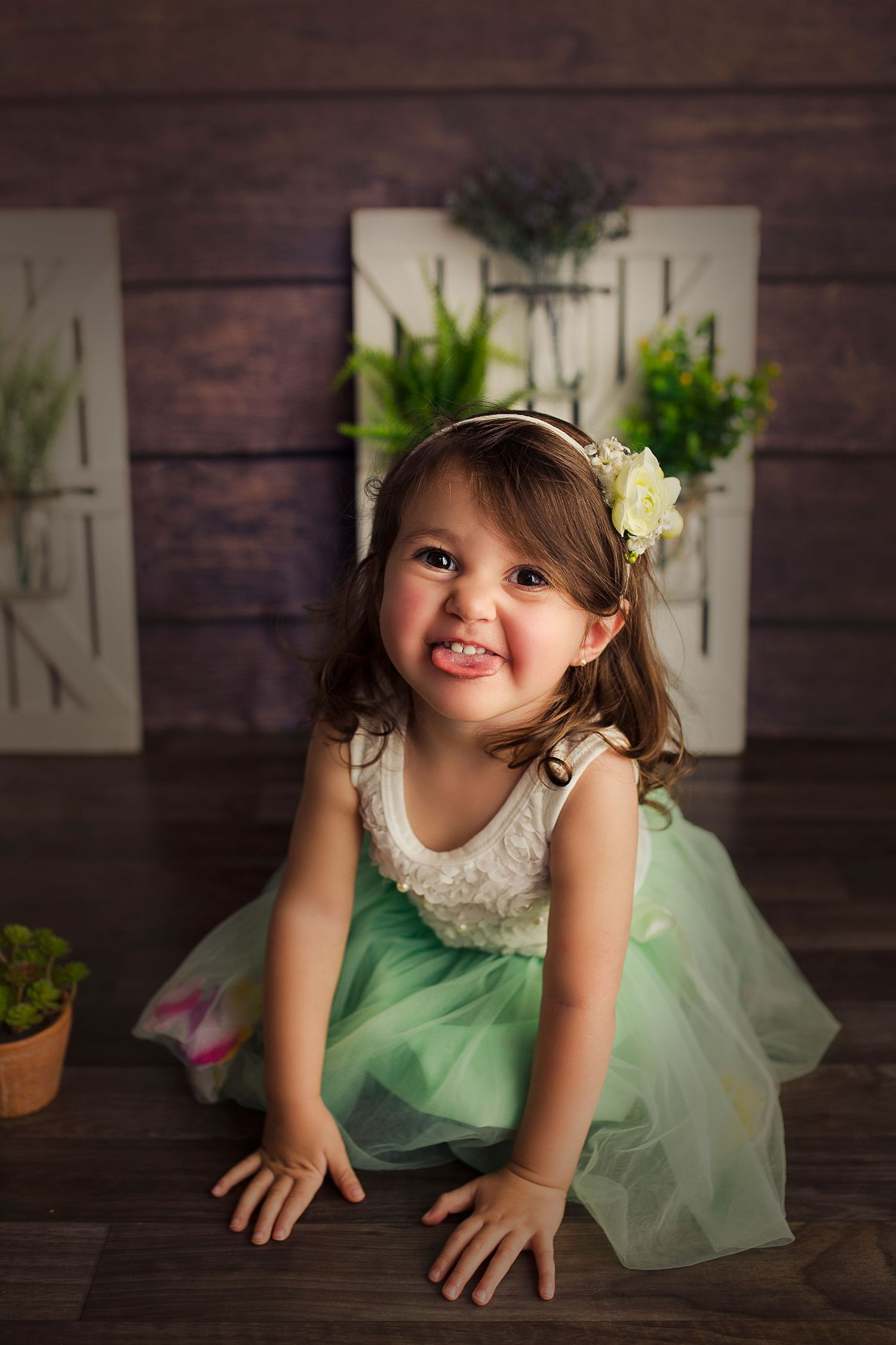 toddler girl sticking tongue out with tulle dress