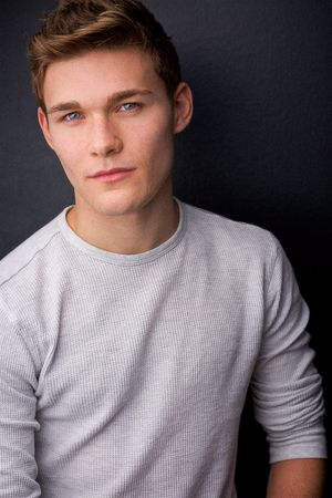 headshots nyc of young actor in thermal again dark background
