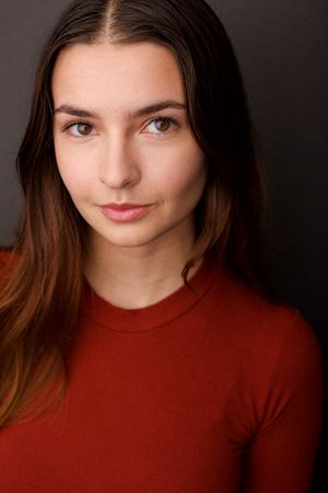 headshots nyc of talia light rake in red sweater