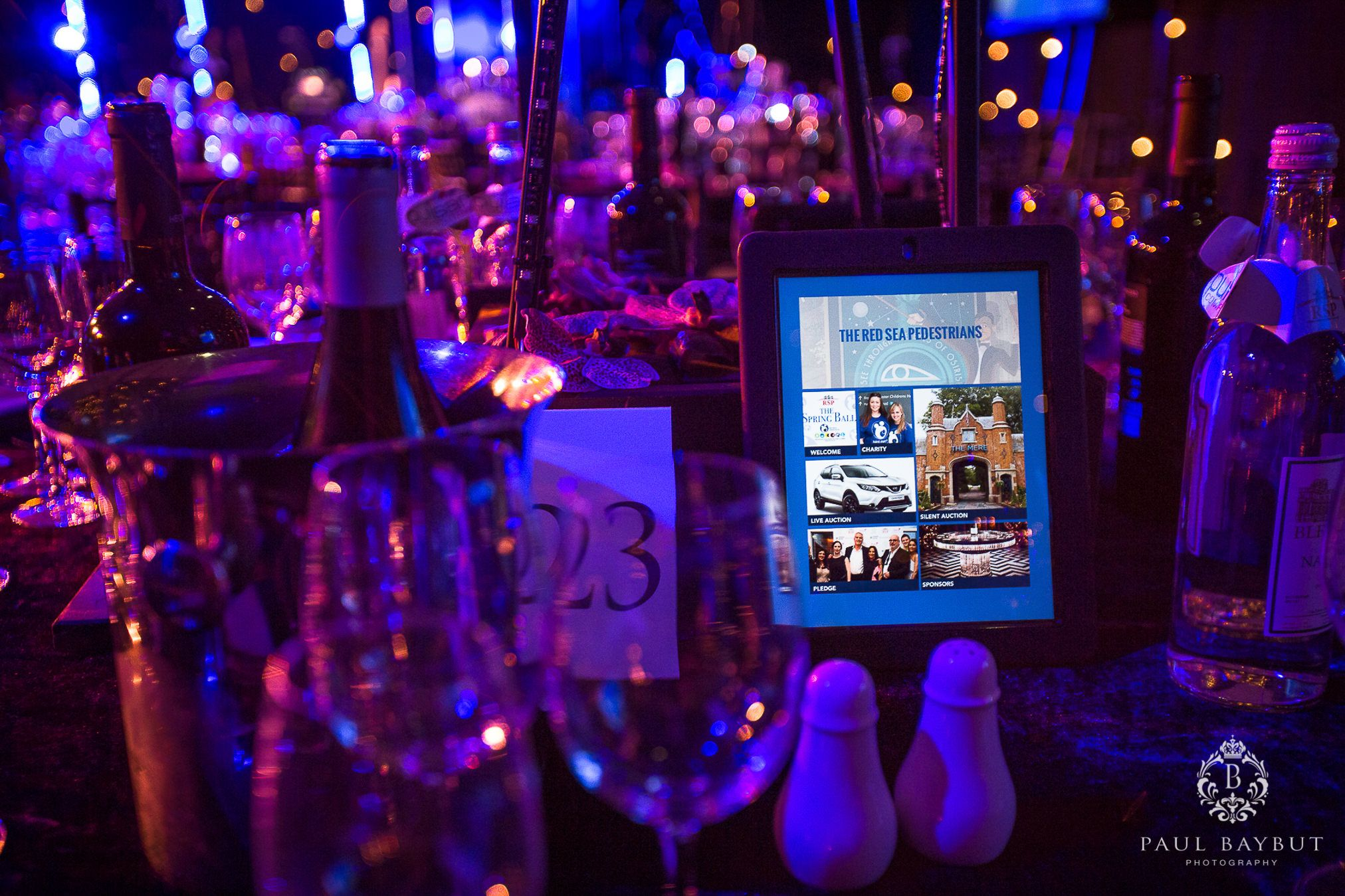 The Red Sea Pestrians charity ball event advertising displayed on a screen at a Manchester hotel
