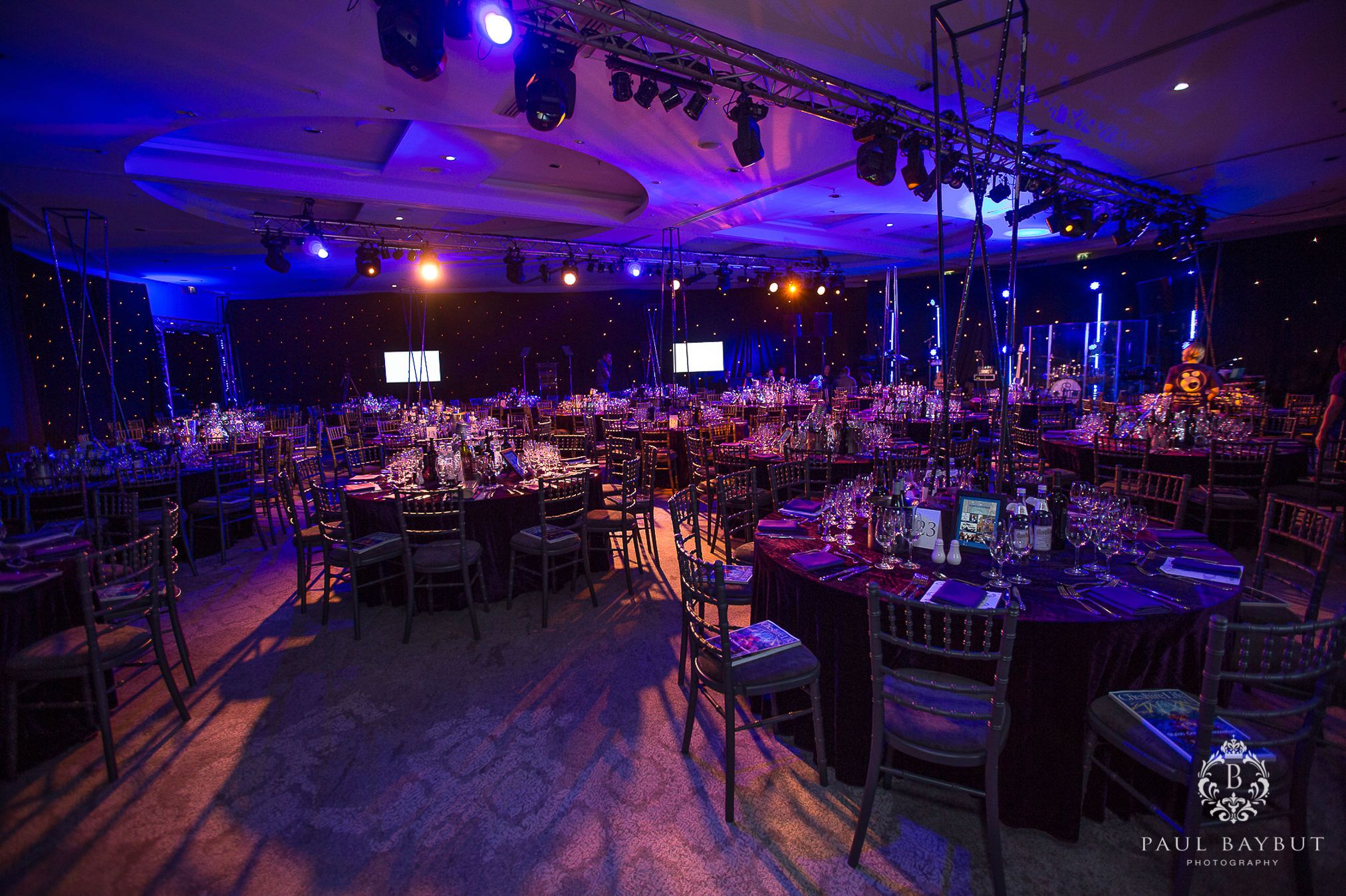 Charity event room in a Manchester hotel of the tables and stage area