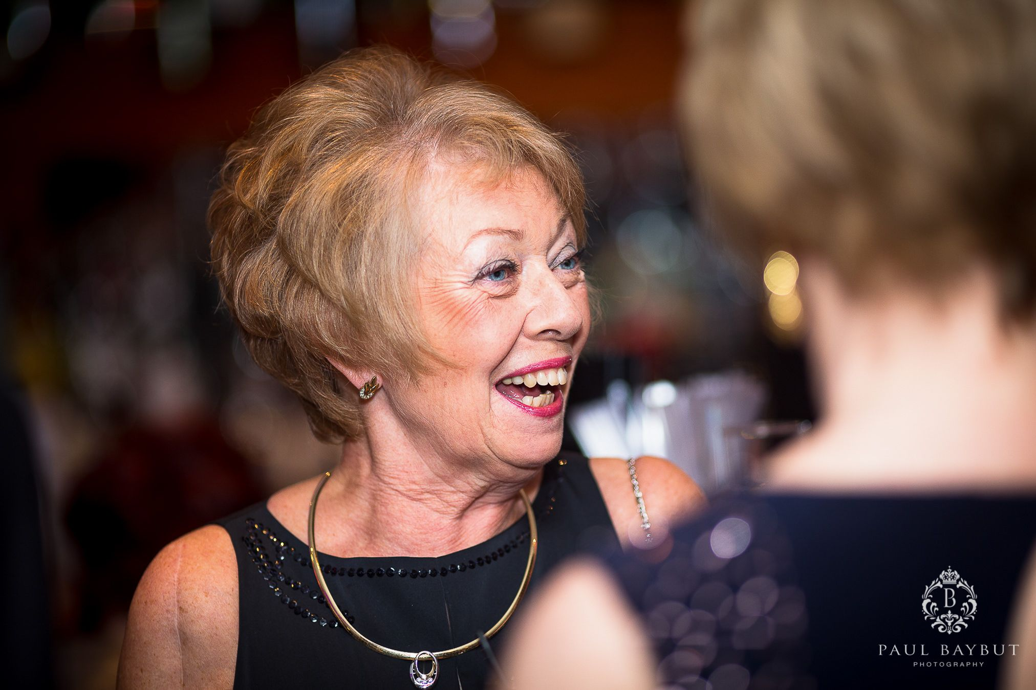 Smiling female guest at a fundraising charity ball event in Manchester