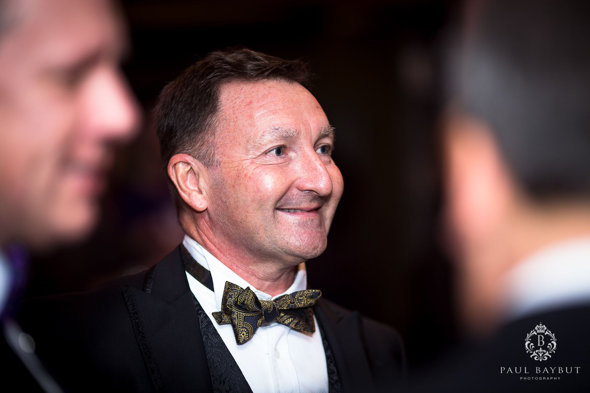Smiling male guest at a fundraising charity ball event in Manchester