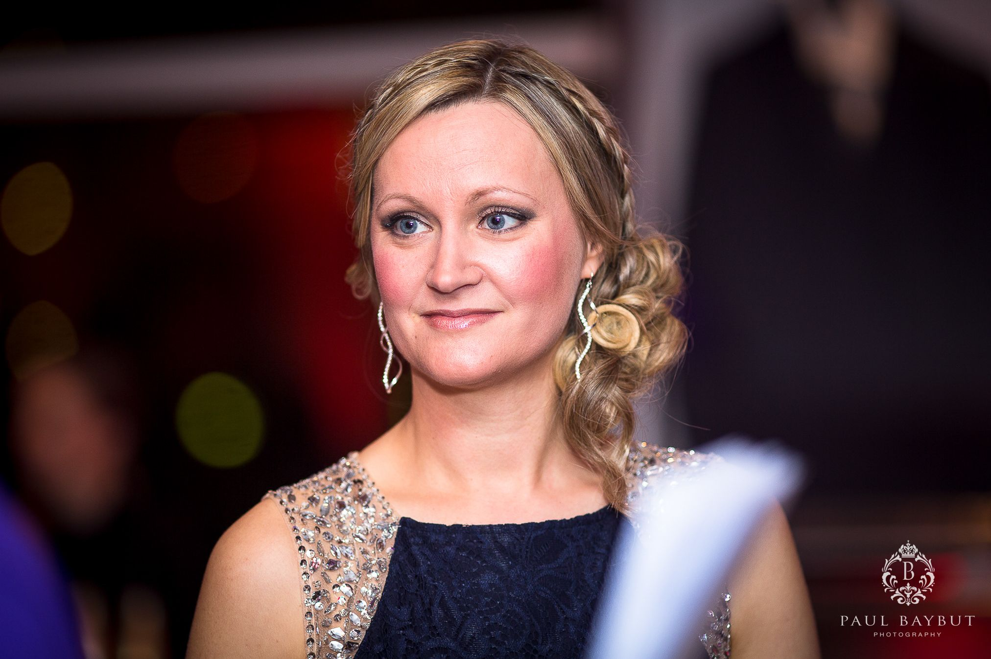 Young glamourous female guest at a fundraising charity ball event in Manchester