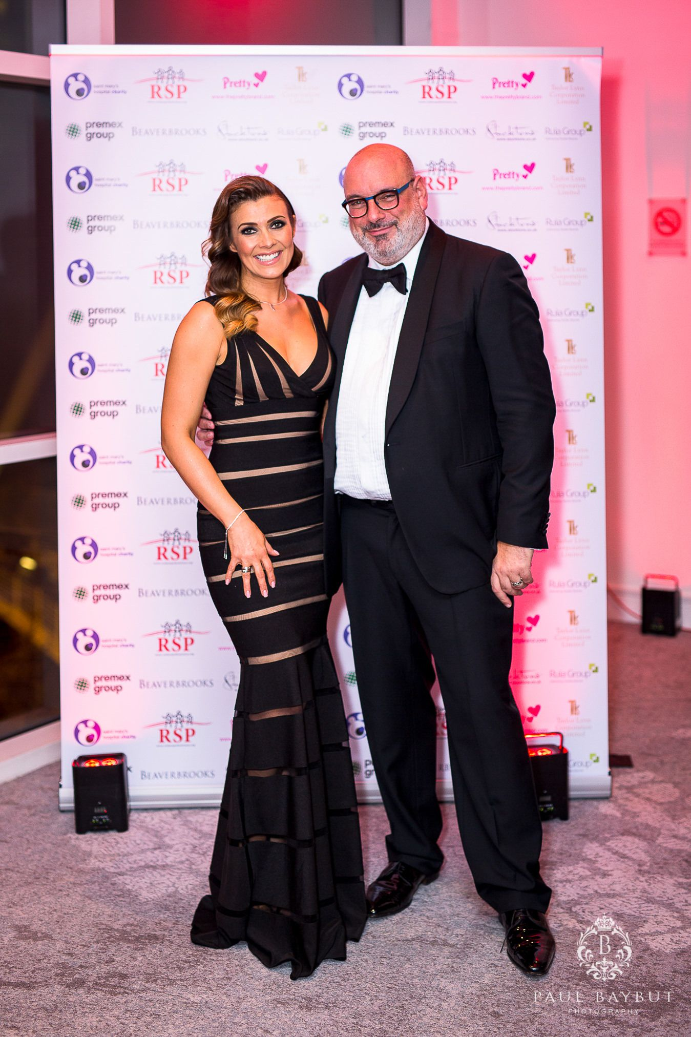 Kim Marsh and event organiser pose for photographs at a Manchester Charity event evening