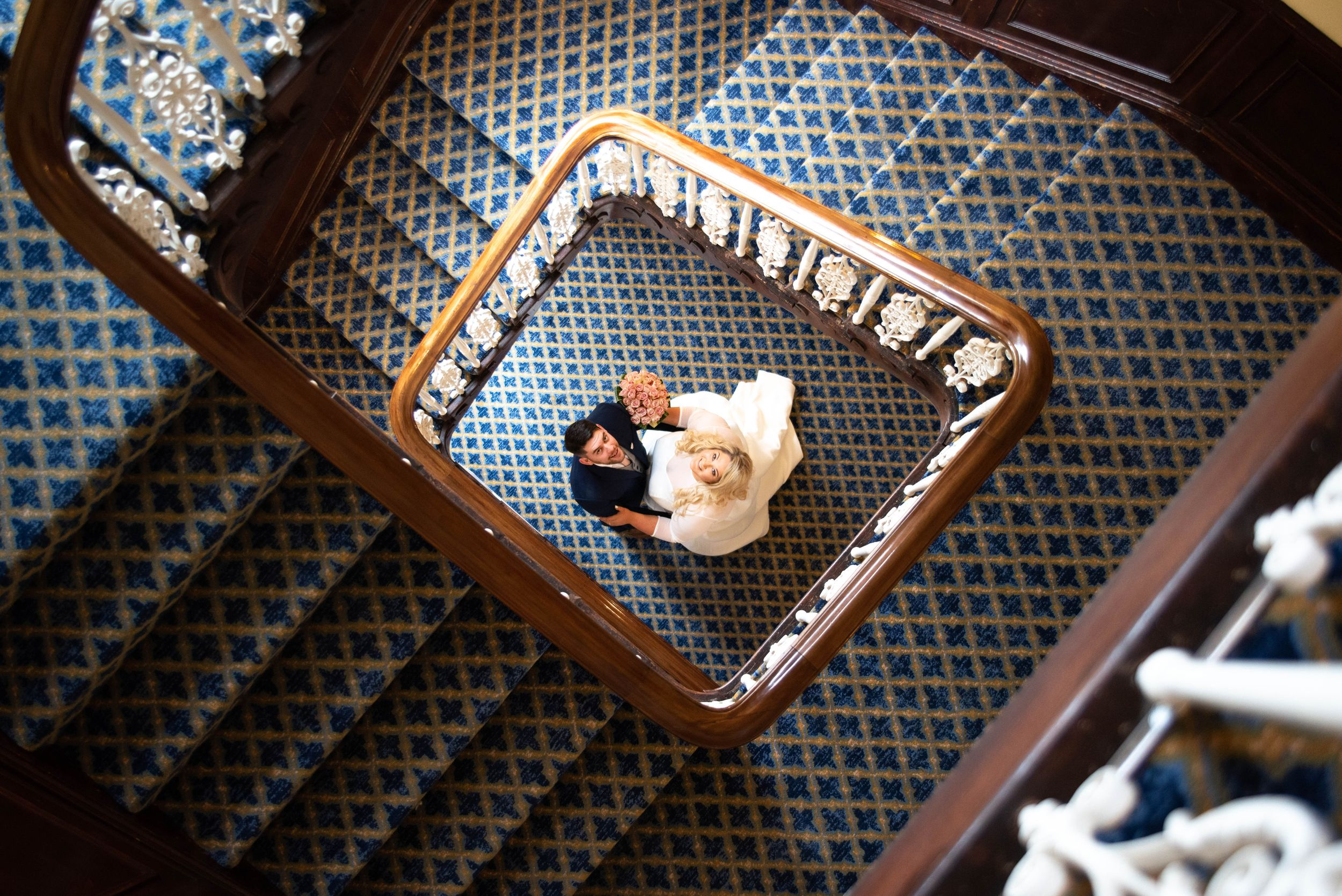 Zara Davis Wedding Photography Tewkesbury Hiltn Pukrup Hall Gloucestershire looking up staircase