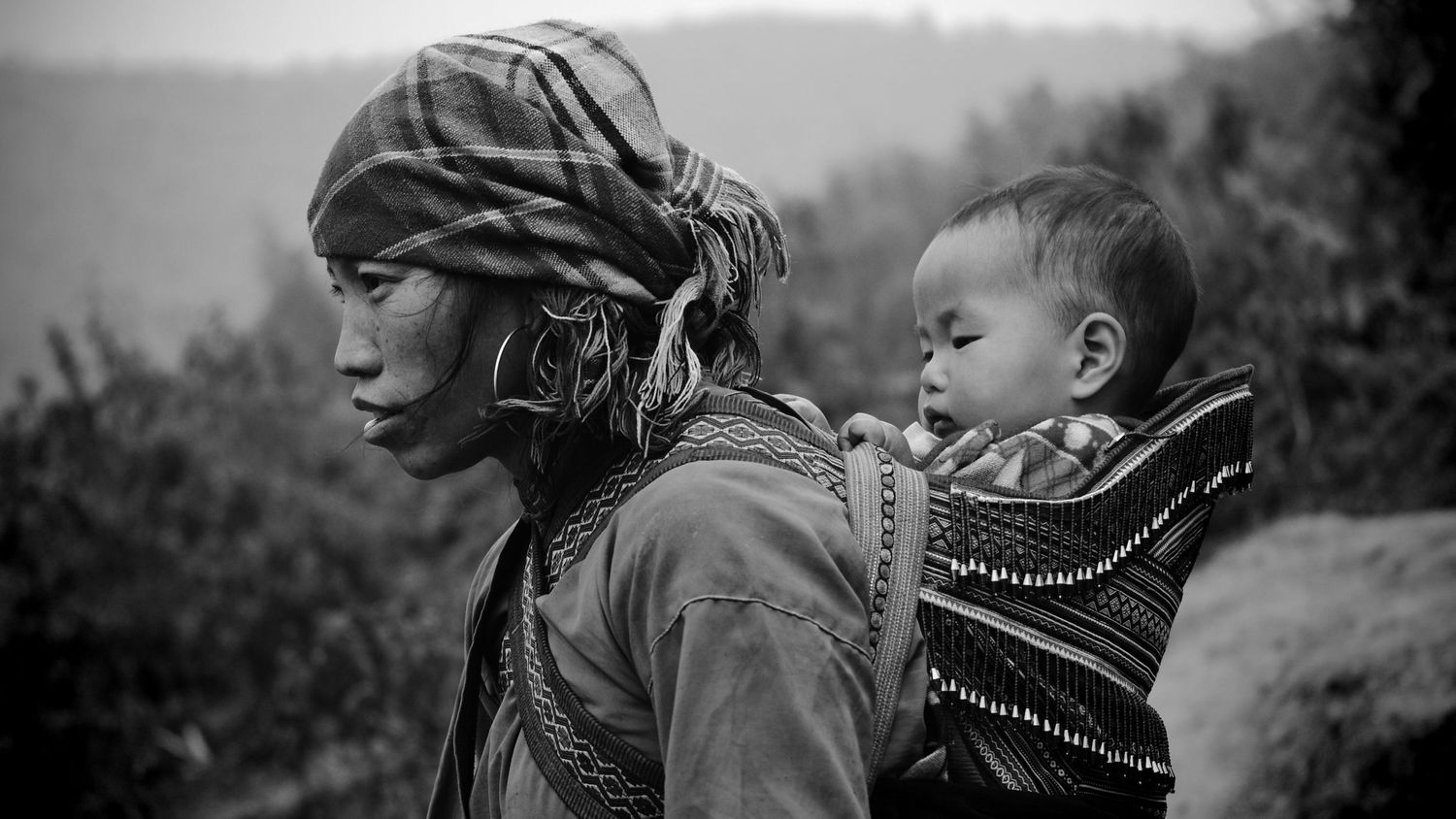 Hmong mother with child. Sapa, Vietnam.