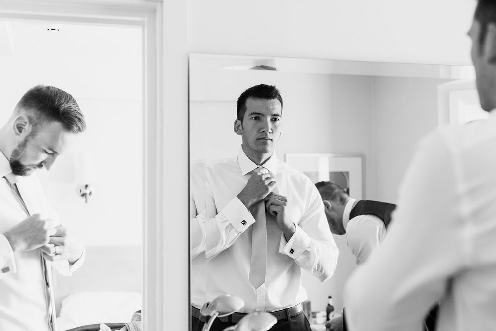mirror photograph groom tie