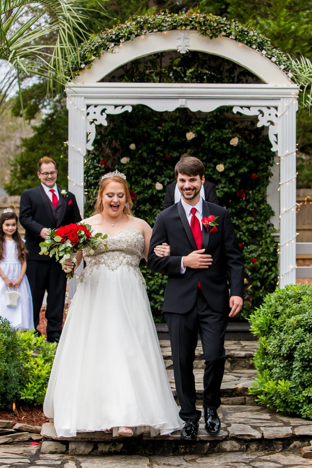 Bride and groom walk down the aisle after their wedding ceremony at Winter Green Woods in Lexington, SC