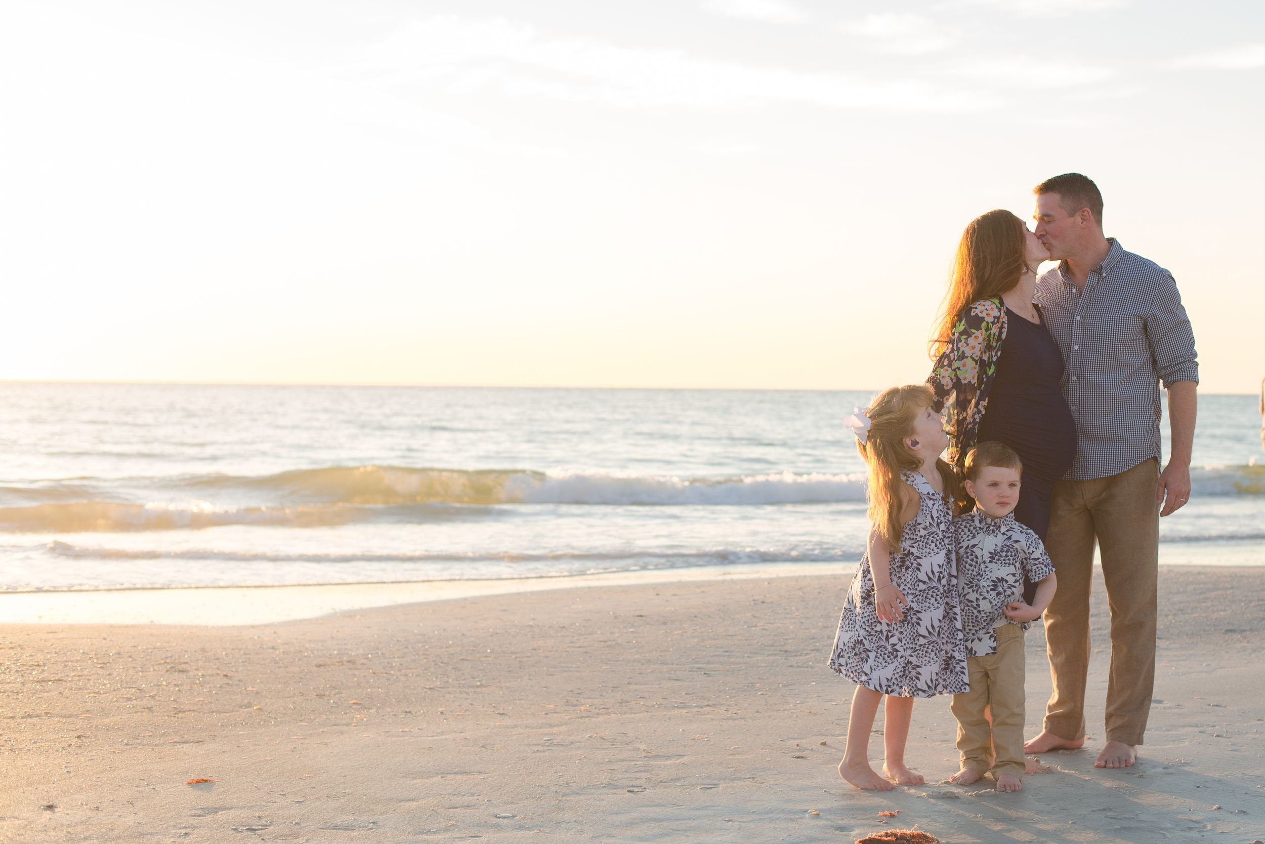 Family with maternity on Redington beach during sunset