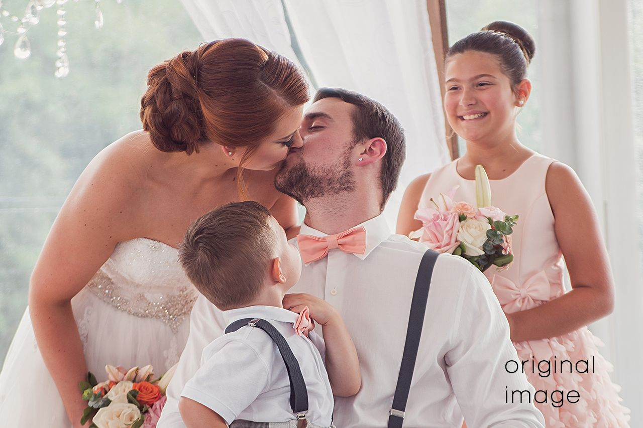 6x4 image of bride and groom kissing while children look on