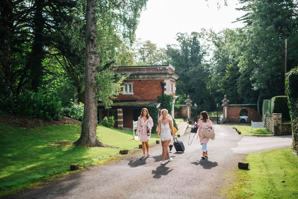 bride and bridesmaids walking from the lodge to the bridal suite at eaves hall, eaves hall wedding, wedding photography